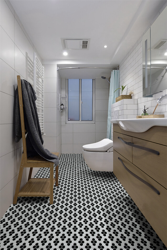 highlight your bathroom with black and white snowflake patterned floor tiles.jpg