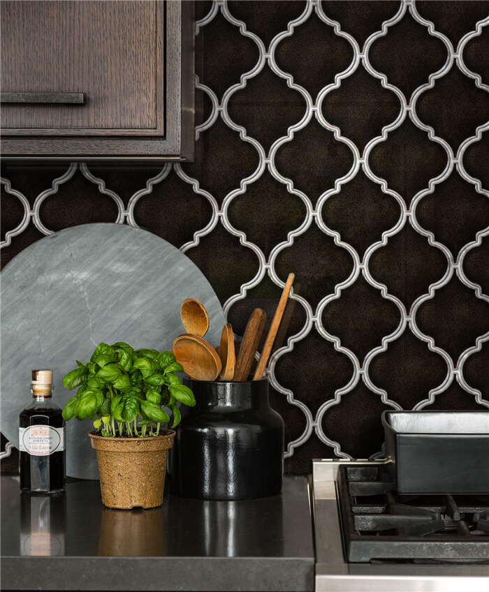 chocolate brown fambe patterned lantern tile as kitchen backsplash.jpg
