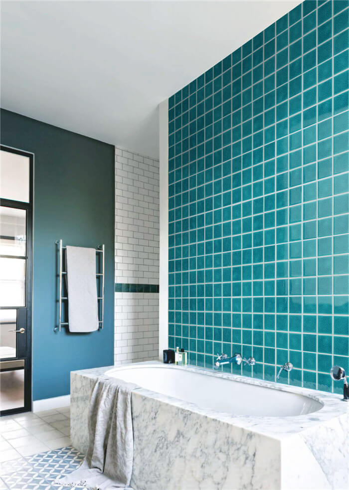 bathroom decorative wall install with blue pool tiles.jpg