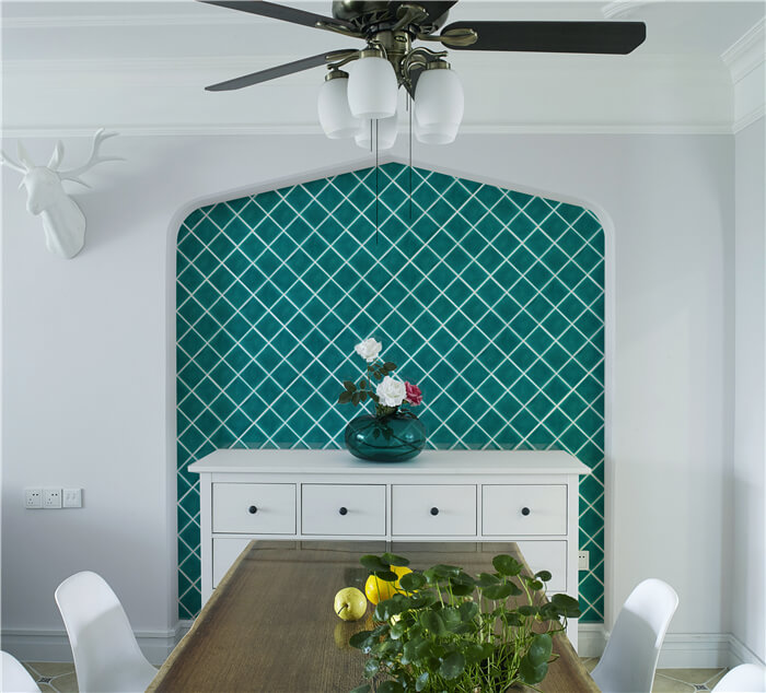 natural green mosaic screen wall decorates the dinning room.jpg