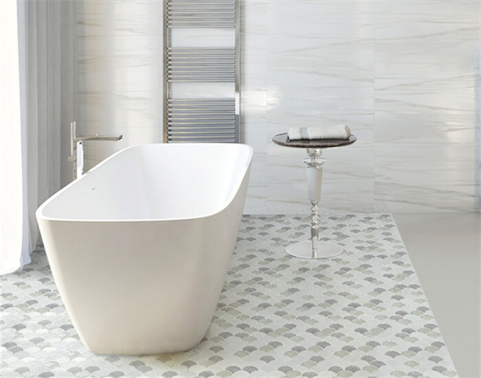 shower room using blended material fan shaped mosaic tile on the floor that surrounds the bathtub.jpg