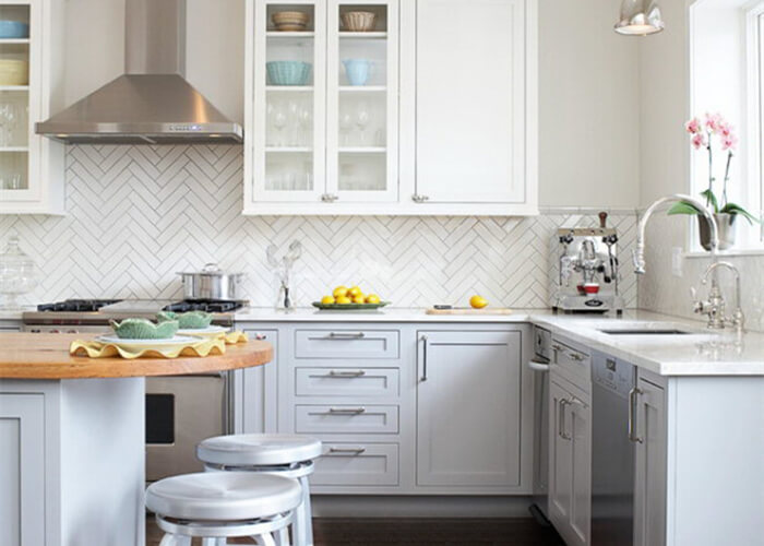 kitchen using classic white herringbone tile for backsplash decoration.jpg