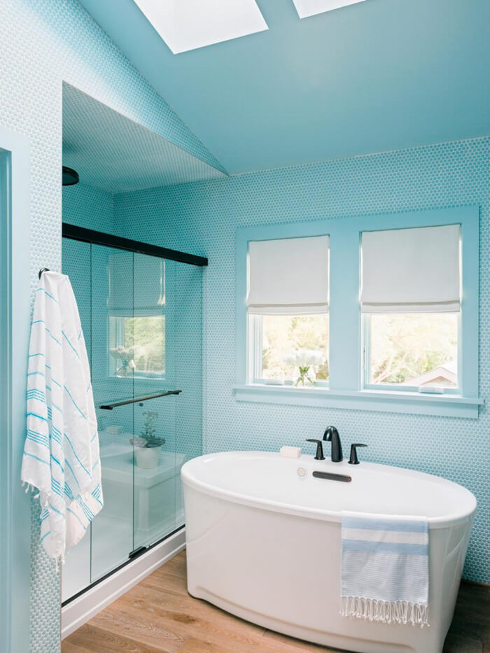 a beautiful bathroom with blue penny tile all around decorated.jpg